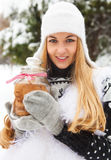 Smiling woman holding cookies jar in her hands Stock Images