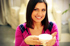 Smiling woman holding cup of coffee Stock Image