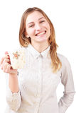 Smiling woman holding a cup isolated on white. Young smiling woman holding a cup isolated on white background Royalty Free Stock Image