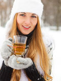Smiling woman holding cup of tea in her hands Royalty Free Stock Photography
