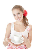 Smiling woman holding cup of tea. Stock Photos