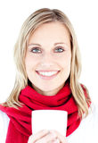 Smiling woman holding a cup in the winter Royalty Free Stock Images