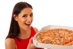 Smiling woman holding delicious pizza in carton box. Royalty Free Stock Photo