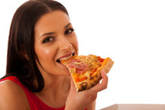 Smiling woman holding delicious pizza in carton box. Royalty Free Stock Photography