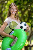 Smiling woman holding different things Stock Photography