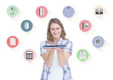 Smiling woman holding digital tablet and various application surrounded by her Stock Photo