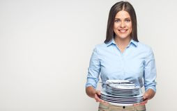 Smiling woman holding dishes plates table set. Catering concept Stock Image