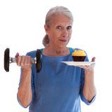 Smiling Woman Holding Dumbbell and Cupcake Royalty Free Stock Photo