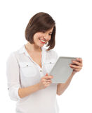 Smiling woman holding an electronic tablet Stock Photo