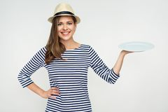 Smiling woman holding empty white plate. Studio portrait Royalty Free Stock Photo