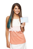 Smiling woman holding envelope Royalty Free Stock Photos