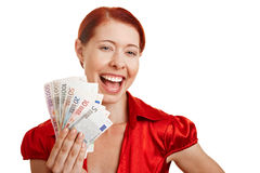 Smiling woman holding Euro money Royalty Free Stock Images