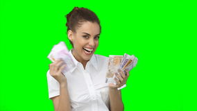 A smiling woman holding a fan of cash in her hand Stock Image
