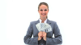 Smiling woman holding a fan of notes Royalty Free Stock Images