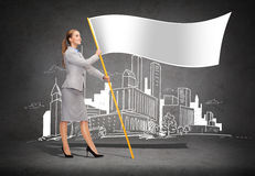 Smiling woman holding flagpole with white flag. Business and advertisement concept - smiling woman holding flagpole with white flag stock images