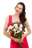Smiling woman holding flowers. A smiling beautiful woman holding flowers and looking at copy-space. Isolated on white stock photos