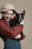 Smiling Woman Holding French Bulldog Royalty Free Stock Photography
