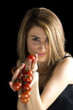 Smiling woman is holding a fresh tomatoes Stock Image