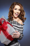 Smiling woman holding gift Royalty Free Stock Image