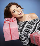 Smiling woman holding gift Stock Photos
