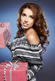 Smiling woman holding gift Stock Photo