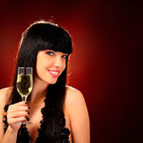 Smiling woman holding a glass of champagne Royalty Free Stock Photography