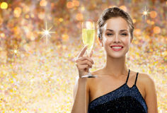 Smiling woman holding glass of champagne Royalty Free Stock Image