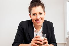 Smiling Woman Holding Glass of Chocolate Drink Stock Image