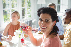 Smiling woman holding glass of red wine Stock Photos