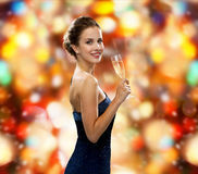 Smiling woman holding glass of sparkling wine royalty free stock image