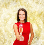 Smiling woman holding glass of sparkling wine Royalty Free Stock Photography