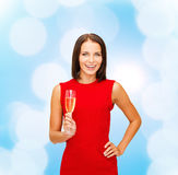 Smiling woman holding glass of sparkling wine Stock Image