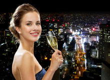 Smiling woman holding glass of sparkling wine Royalty Free Stock Images