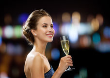 Smiling woman holding glass of sparkling wine. Party, drinks, holidays, people and celebration concept - smiling woman in evening dress with glass of sparkling Stock Photos