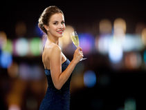 Smiling woman holding glass of sparkling wine Stock Images