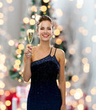Smiling woman holding glass of sparkling wine. Party, drinks, holidays, people and celebration concept - smiling woman in evening dress with glass of sparkling Royalty Free Stock Photos