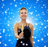 Smiling woman holding glass of sparkling wine. Party, drinks, winter holidays, christmas and celebration concept - smiling woman in evening dress with glass of Stock Images