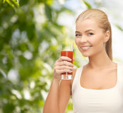 Smiling woman holding glass of tomato juice Royalty Free Stock Photography