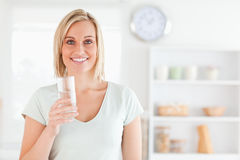 Smiling woman holding glass of water Stock Image