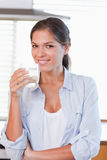 Smiling woman holding a glass of water Royalty Free Stock Image