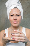 Smiling woman holding glass of water in her hands Stock Image