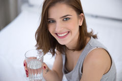 Smiling woman holding glass of water Royalty Free Stock Photo