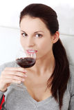Smiling woman holding a glass of wine. Stock Photos