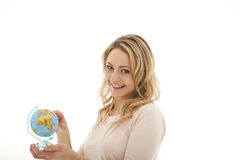 Smiling woman holding globe Royalty Free Stock Photography