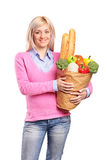 Smiling woman holding a grocery bag Stock Image