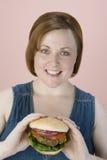 Smiling Woman Holding Hamburger Royalty Free Stock Image