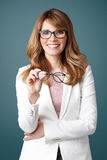 Smiling woman holding in hand eyewear Royalty Free Stock Photos