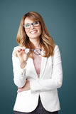 Smiling woman holding in hand eyewear Royalty Free Stock Photo