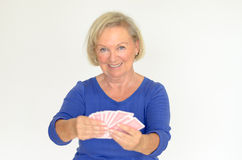 Smiling woman holding a hand of playing cards Stock Images