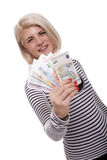 Smiling woman holding a handful of Euro notes. Attractive smiling blond woman holding up a handful of fanned Euro notes in different denominations, tilted angle stock photo